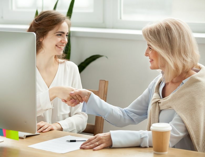 2 women working at computer desk